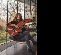 With Timberline Harp Guitar