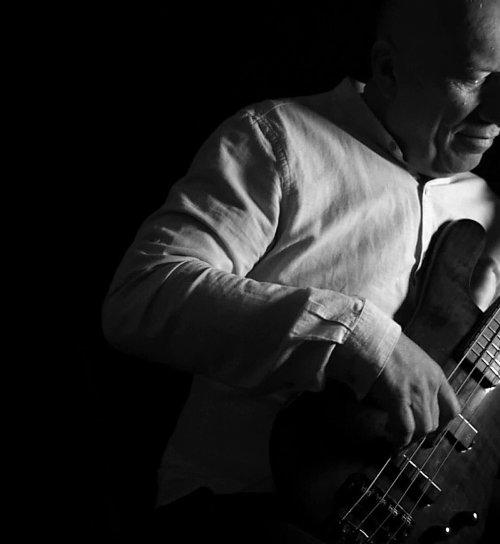 Bass guitarist by Branko Isaković