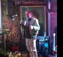 Reciting poetry at The Clutha bar in Glasgow, Scotland